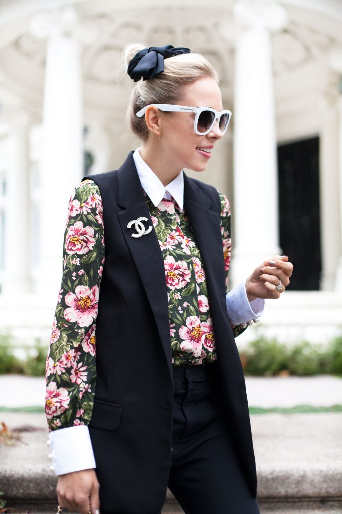 zara PEARL BUTTON BLOUSE WITH BOW | Zara printed blouse with bow styled by top US fashion blog, Lombard and Fifth: image of a blonde woman wearing a Zara floral blouse, Zara pants, Chanel brooch, Valentino heels and a Chanel bag.