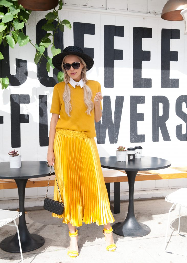 Marigold trend featured by top US fashion blog, Lombard and Fifth: image of a blonde woman wearing a Zara short sleeve sweater, an Anthropologies maxi skirt, TOPSHOP sandals and a Lack of Color wide brim hat