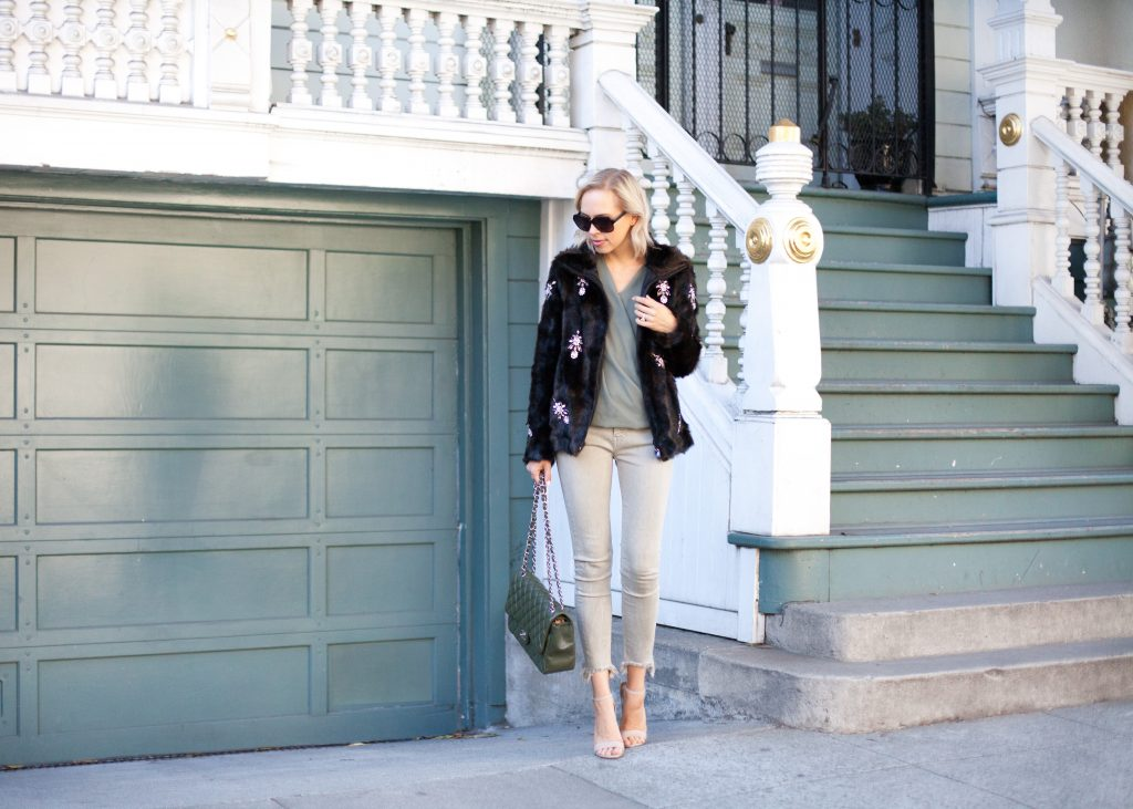 Chanel flap bag featured by The-Collectory featured by top US fashion blog, Lombard and Fifth: image of a woman wearing a Zara bejeweled jacket, Zara skinny jeans.