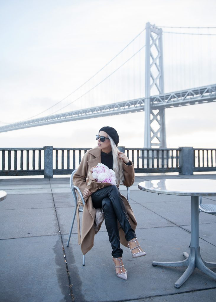 J.Ing Limited coat featured by top US fashion blog, Lombard and Fifth: image of a woman by the Golden Gate bridge in San Francisco wearing a J.Ing Limited coat, J Crew sweater, Diesel leggings.