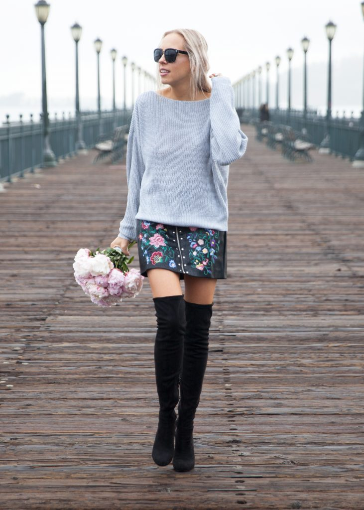 Veronica of Lomard & Fifth blog wears an embroidered leather skirt from Zaful, with a grey backless sweater and fresh pink peonies in San Francisco at Pier 9