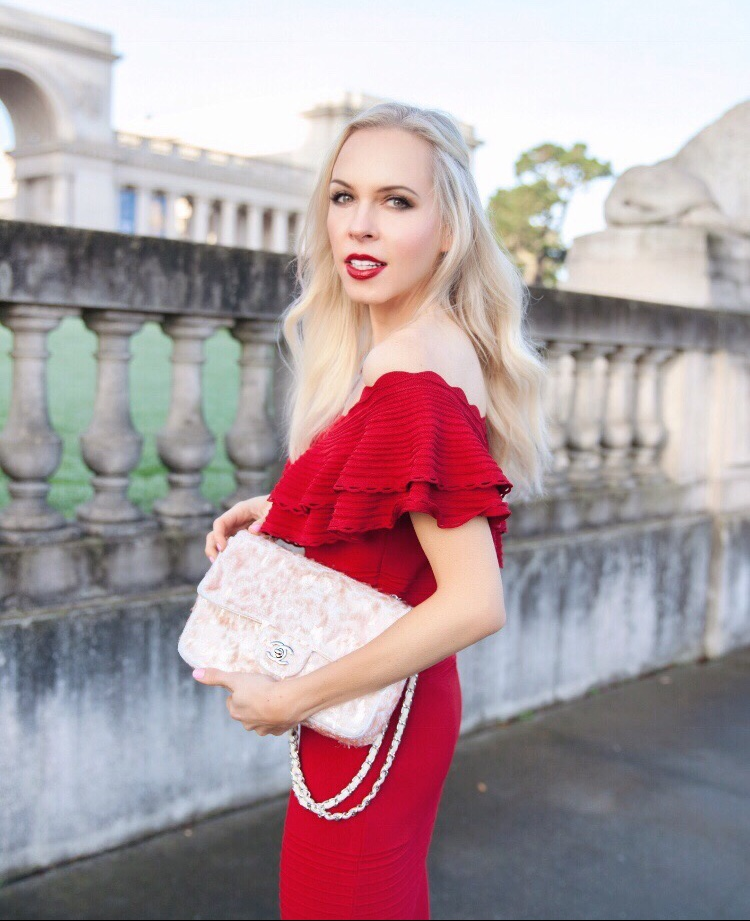 eliza j red dress valentines day style | Red Eliza J Dress styled for Valentine's Day by top US fashion blog, Lombard and Fifth: image of a blonde woman wearing an Eliza Dress of the shoulder dress, Simply faux fur jacket, Rue La La glitter bag and Christian Louboutin shoes