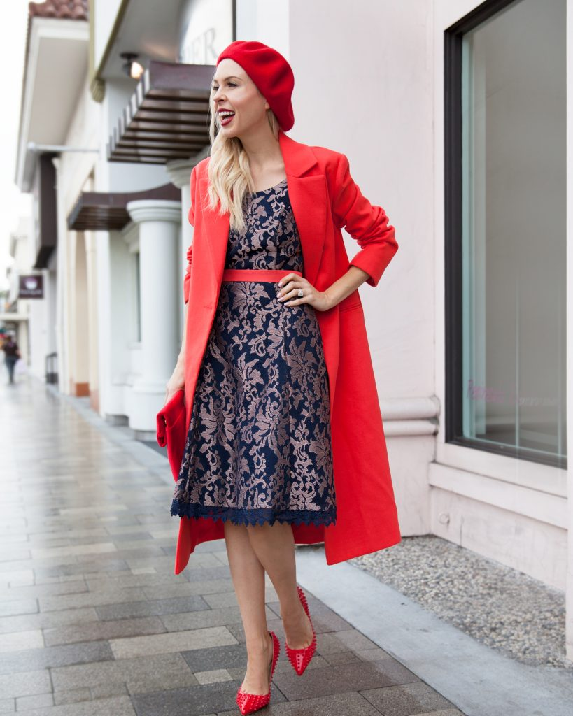 Valentine's Day dress featured by top US fashion blog, Lombard and Fifth: image of a blonde woman wearing a Review Australia floral dress, ASOS red coat, Urban Outfitters red beret and an Anthropologie clutch