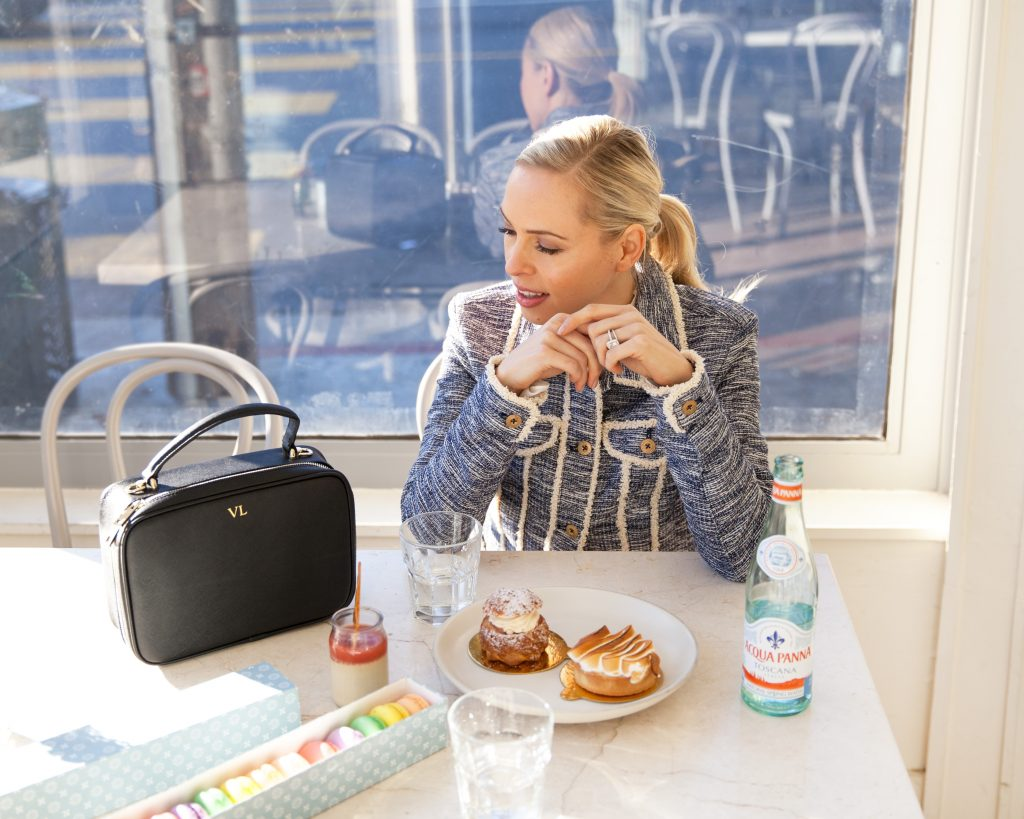 luxemono monogrammed camera bag Le Marais Bakery San Francisco  featured by top US fashion blog Lombard and Fifth: image of a blonde woman with the Luxemono Carly Camera Bag