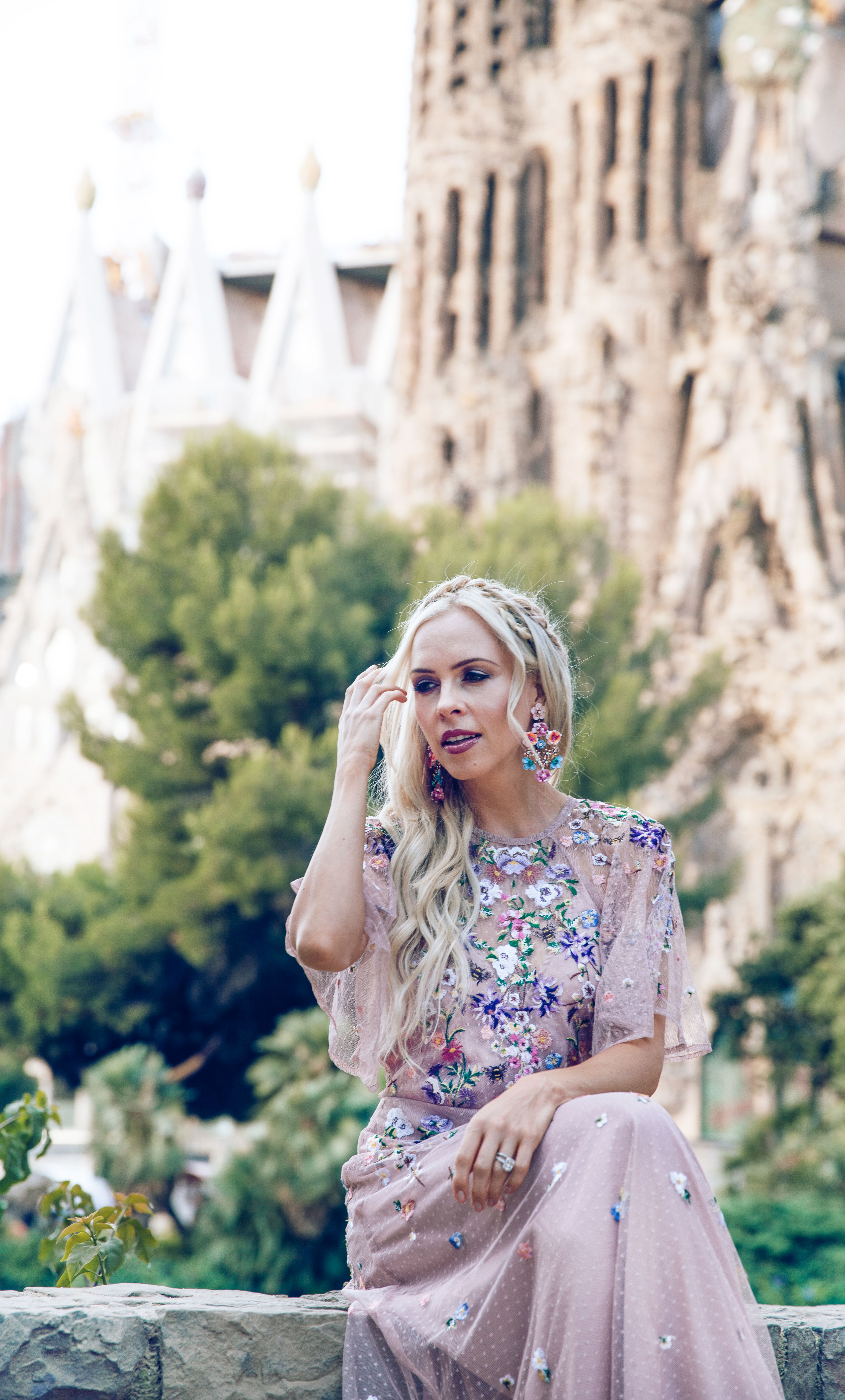 Barcelona La Sagrada Familia ASOS DESIGN Bridesmaid floral embroidered dobby mesh flutter sleeve maxi dress in barcelona  | ASOS floral embroidered maxi dress featured by top San Francisco fashion blog, Lombard and Fifth: image of a blonde woman wearing a floral maxi dress at the Colosseum in Rome
