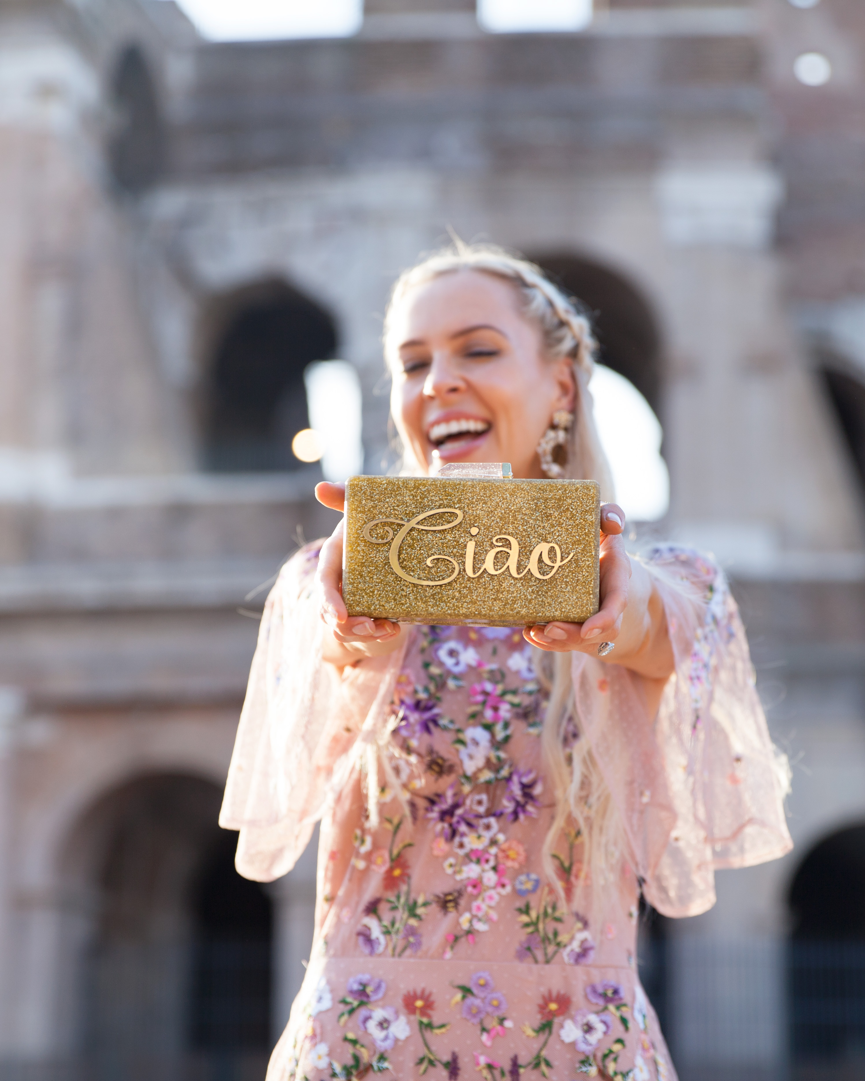ASOS DESIGN Bridesmaid floral embroidered dobby mesh flutter sleeve maxi dress in barcelona in Rome  | ASOS floral embroidered maxi dress featured by top San Francisco fashion blog, Lombard and Fifth: image of a blonde woman wearing a floral maxi dress at the Colosseum in Rome