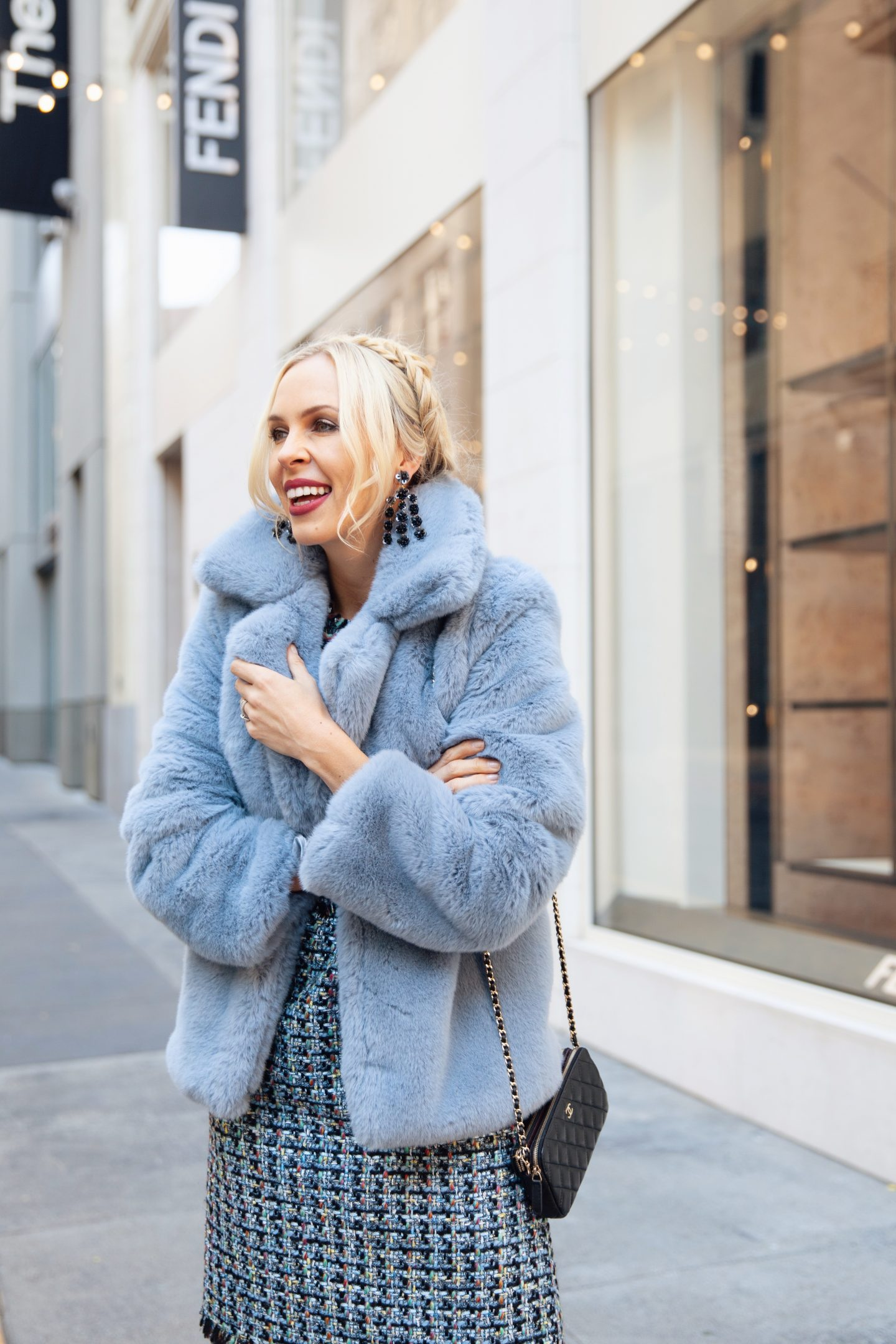 Best faux fur jackets featured by top San Francisco fashion blog, Lombard and Fifth: image of a woman wearing a Rent the runway faux fur jacket
