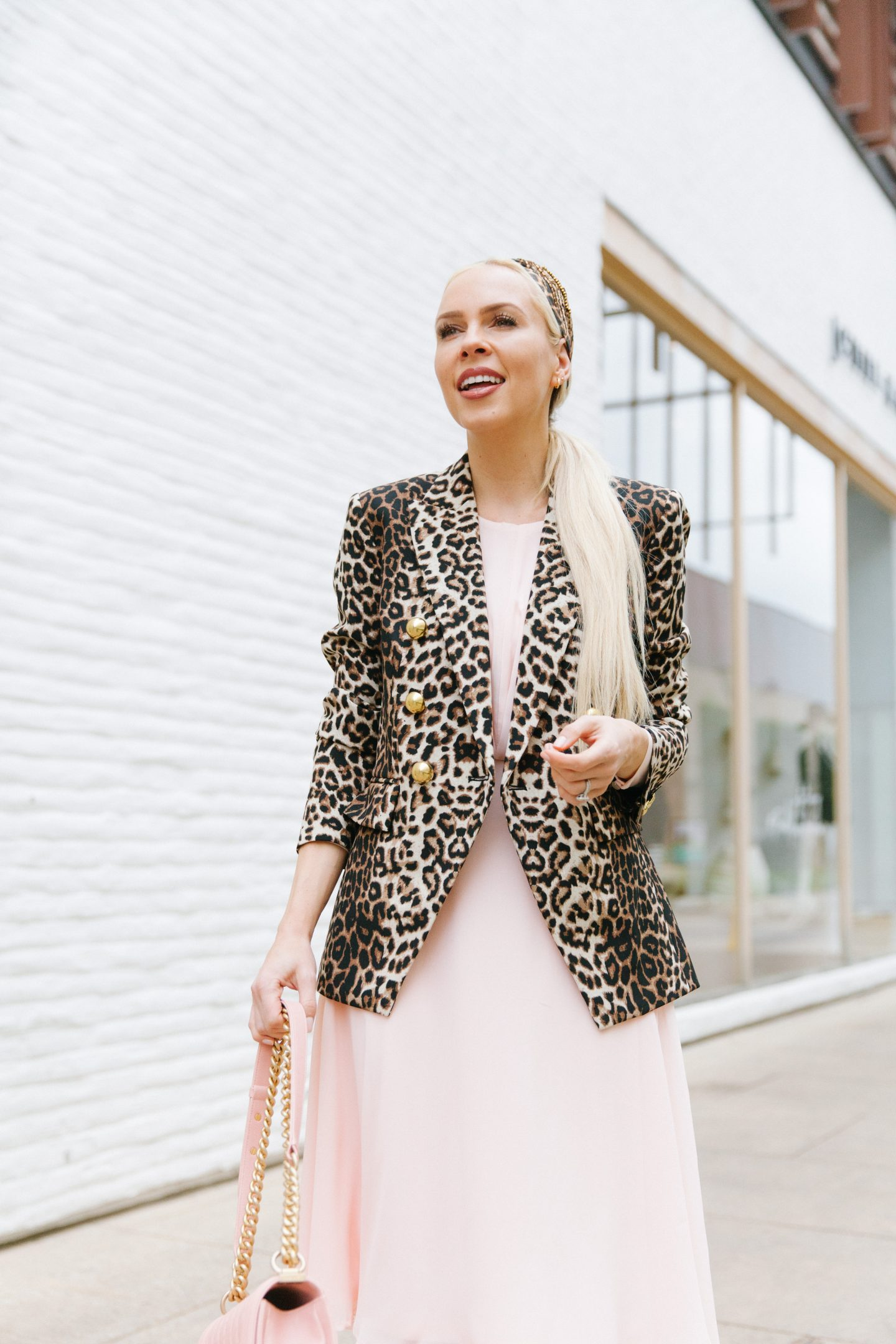 Top US fashion blog, Lombard and Fifth, features her styling tips to take the Leopard Print Fashion into Spring: image of a woman wearing a Veronica Beard leopard jacket, JC Penney fit and flare dress, Namjosh leopard headband, and an Anthropologie crossbody bag