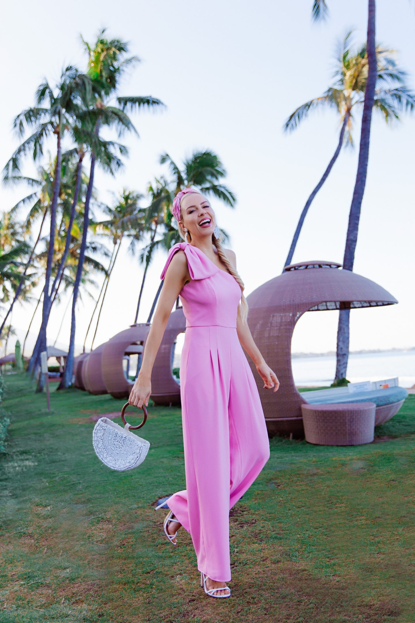 Gal Meets Glam pink wedding guest jumpsuit featured by top US fashion blog Lombard and Fifth