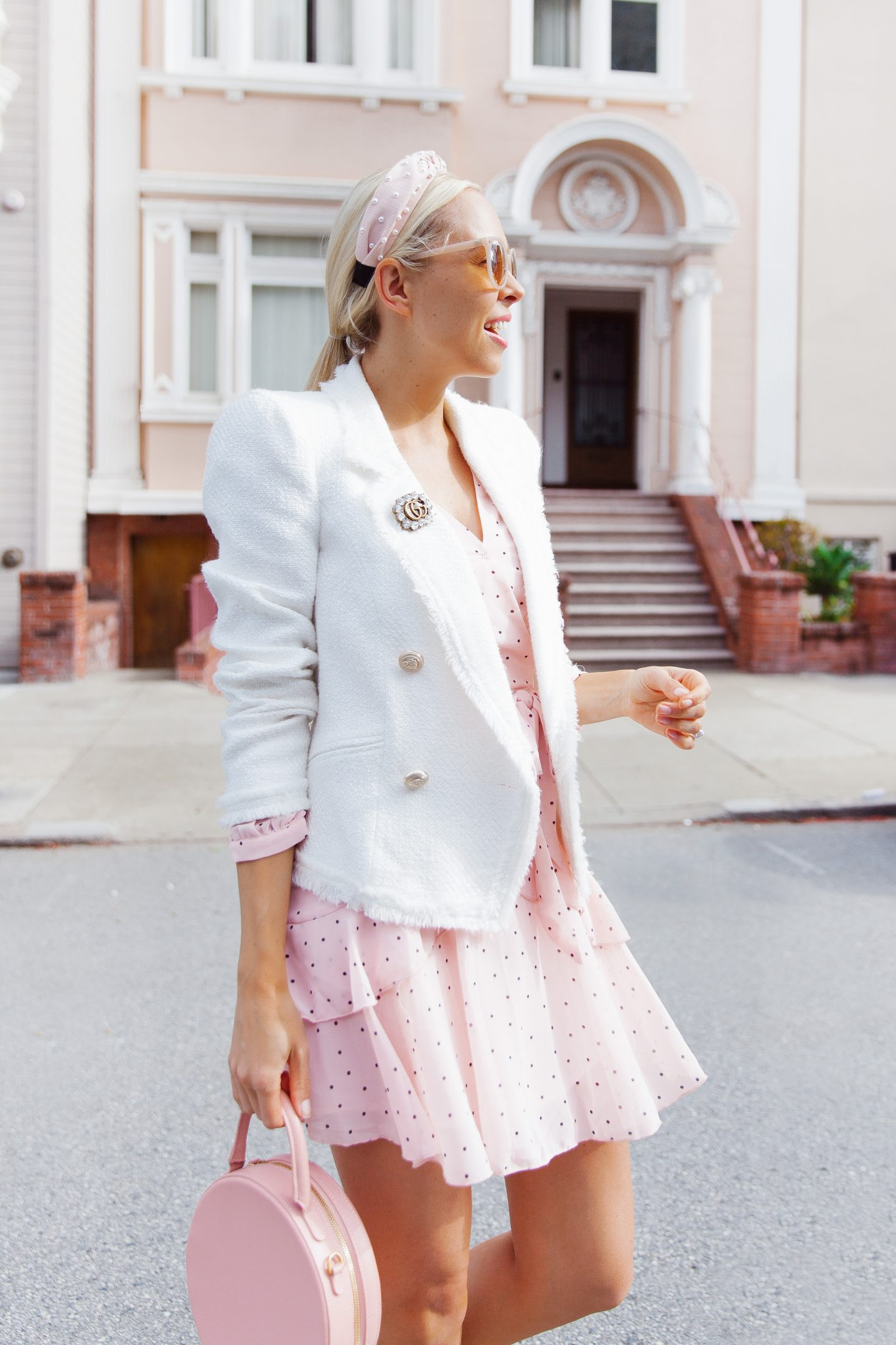Stylish Spring Work Outfits featured by top US fashion blog, Lombard and Fifth: image of a woman wearing a Chicwish pink dress and River Island white blazer