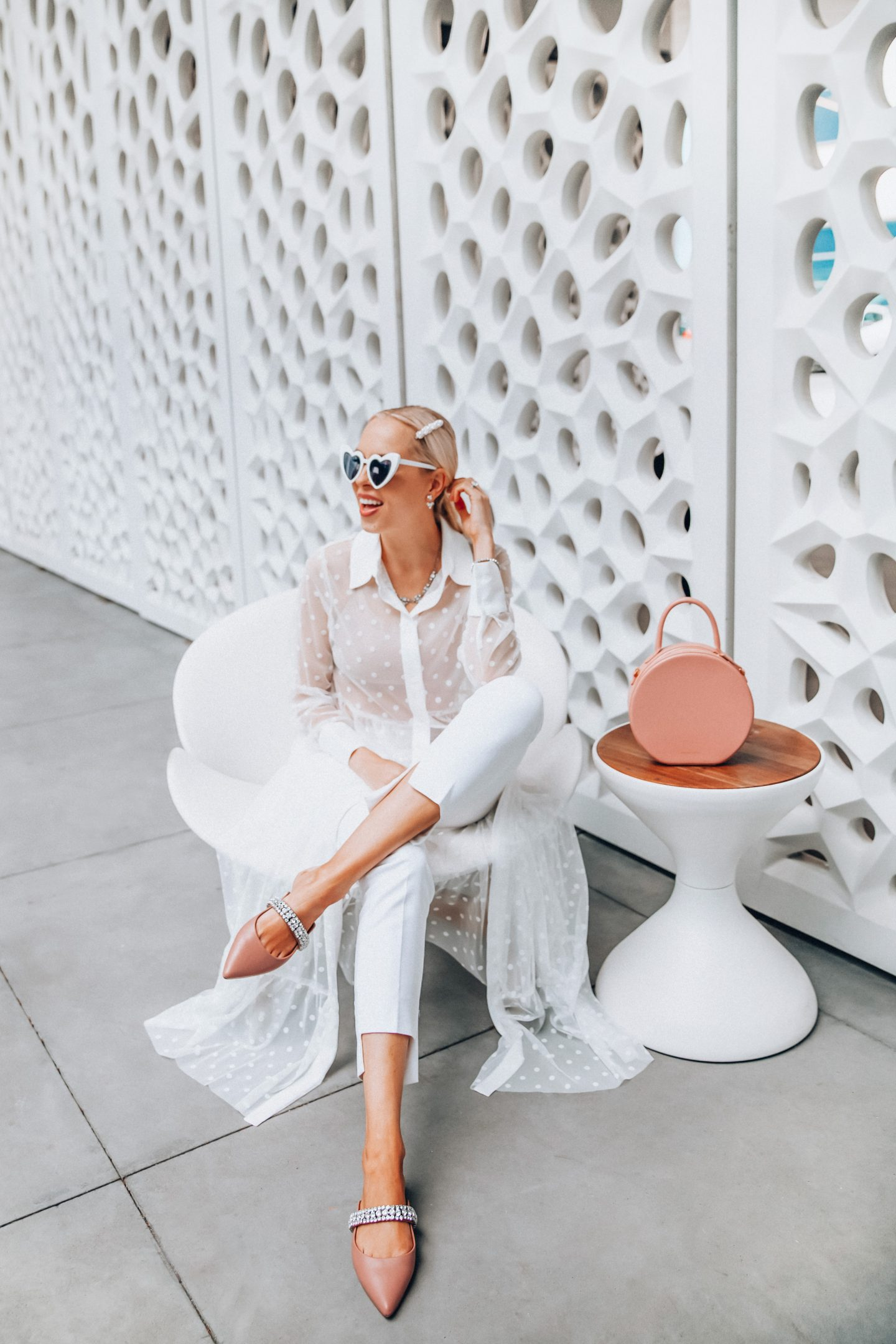 Cute summer shoes available at Zappos featured by top US fashion blog, Lombard and Fifth: image of a blonde woman wearing Kurt Geiger London Princely pink flat mules