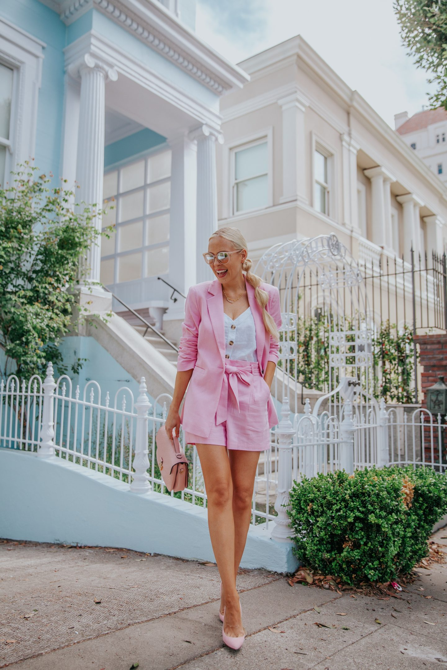 Shorts suits styled for the Summer by top US fashion blog, Lombard & Fifth: image of a woman wearing a Hologen shorts suit, Abercrombie & Fitch cami, Louis Vuitton Empreinte Pochette, and H&M sunglasses