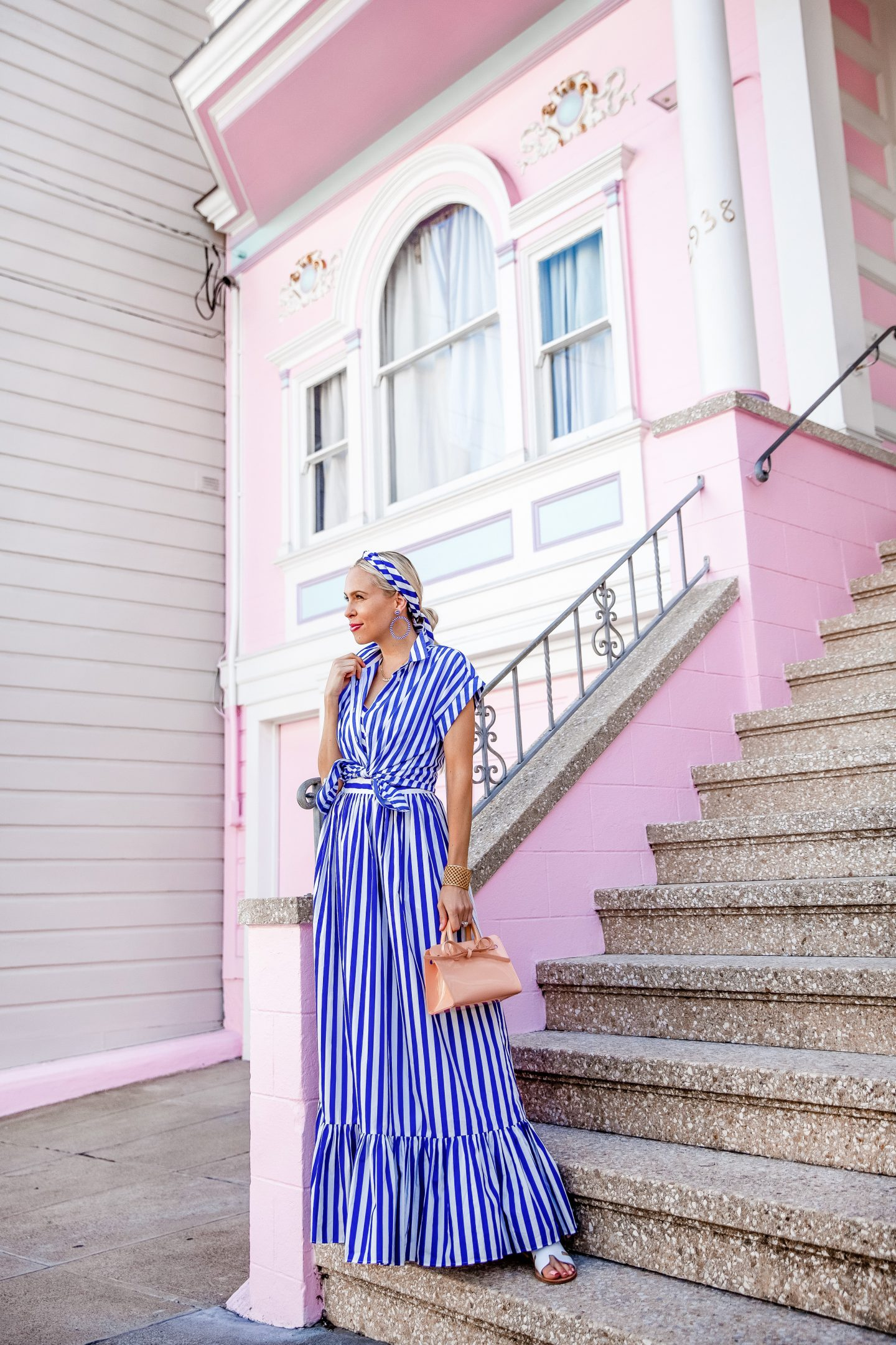 National Striped Day featured by top US fashion blog, Lombard & Fifth: image of a woman wearing a Crew striped maxi dress, JCrew beaded hoops, Mansur Gavriel mini sun bag, Steve Madden Greece sandals