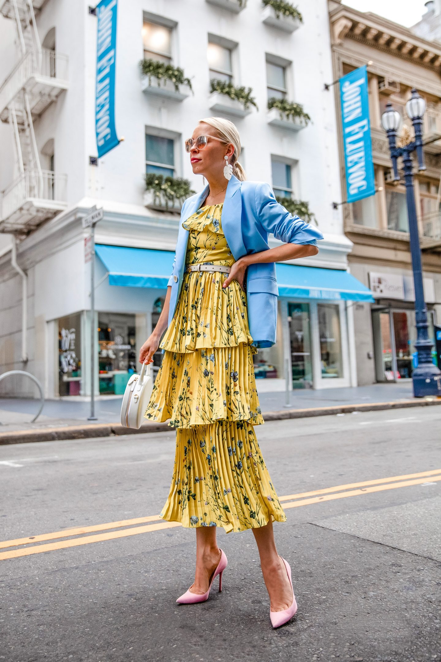 One Floral Maxi Dress from Day to Night featured by top US fashion blog, Lombard and Fifth: image of a woman wearing an AQUA maxi floral dress, TOPSHOP light blue blazer, Christian Louboutin suede heels, Anthropologie pearl earrings, and Mansur Gavriel crossbody bag