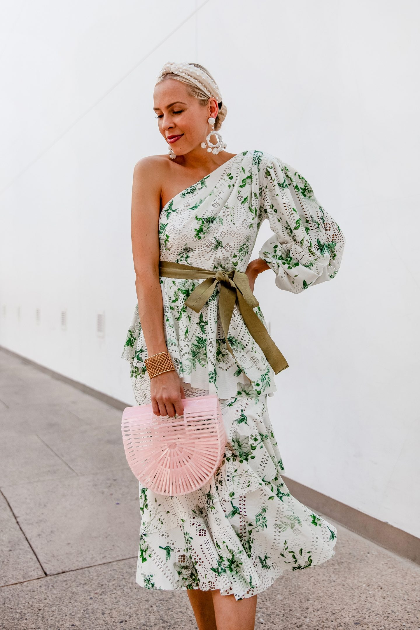 Stylish Special Occasion Dresses for Summer featured by top US fashion blog, Lombard and Fifth: image of a woman wearing Red Dress Boutique statement earrings, ASOS one shoulder dress, Cult Gaia mini ark bag, pearl headband, and Schutz sandals