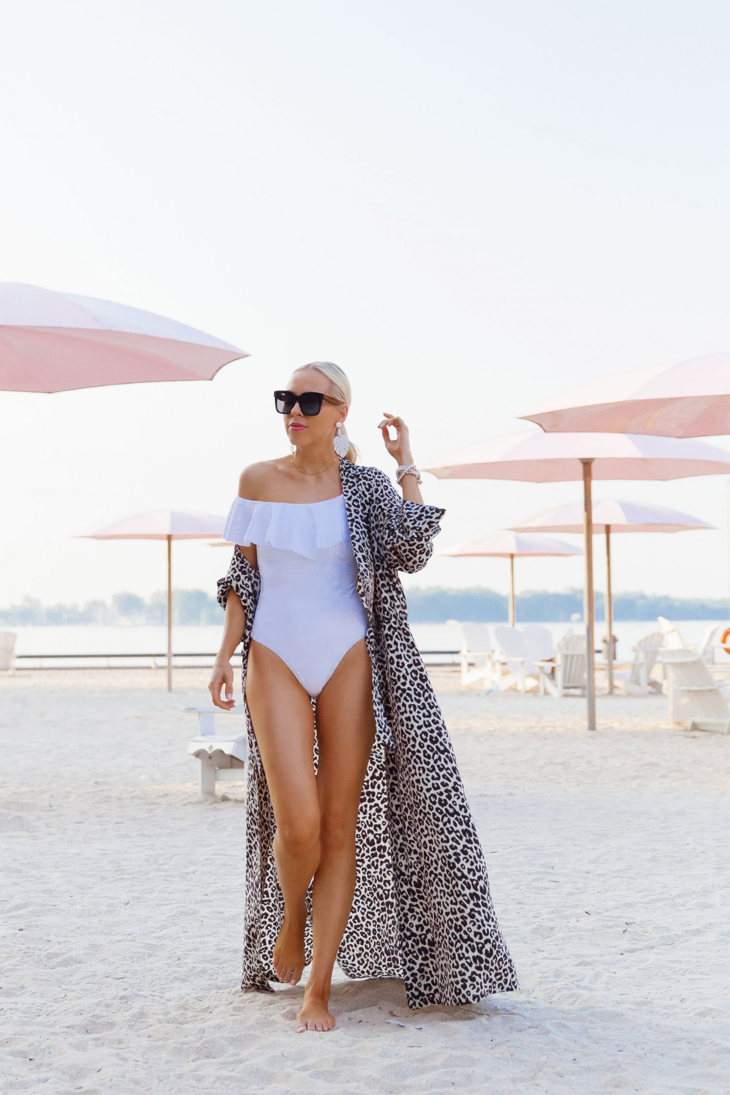Sugar Beach Toronto featured by top US life and style blog, Lombard and Fifth: image of a woman wearing a Something Navy swimsuit and leopard robe on Sugar Beach Toronto