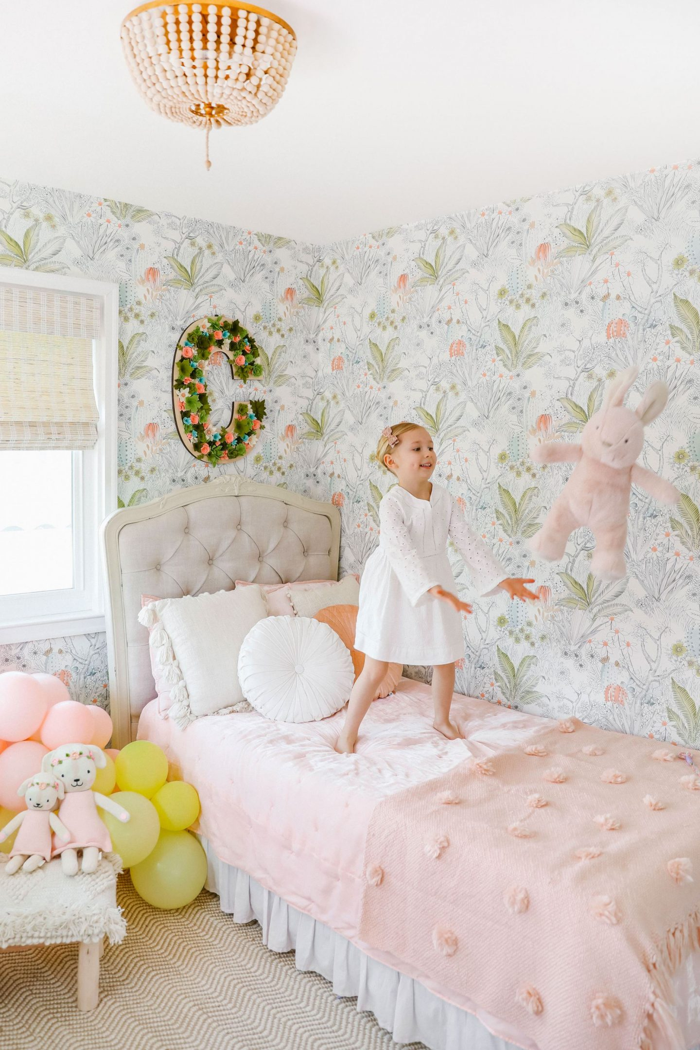 Green and pink boho girls room décor inspiration with Anthropologie wallpaper, Paynes Gray rug, select blinds wooden shades. By top San Francisco fashion blog, Lombard and Fifth.