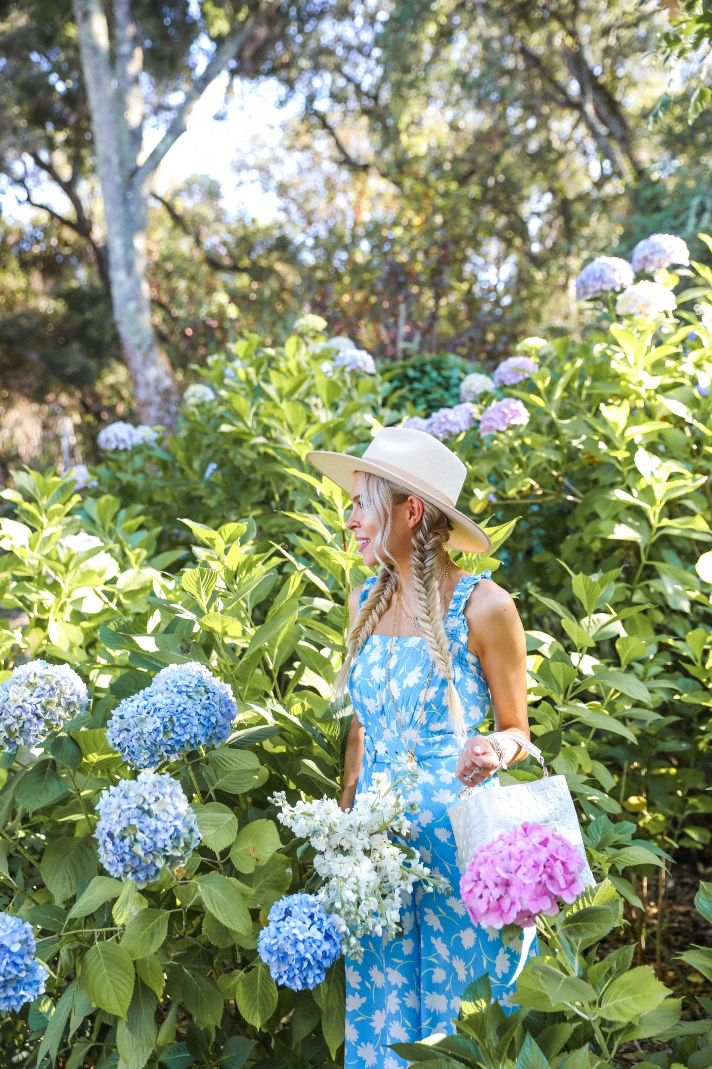 Faithful the brand jumpsuit shopbop in a hydrangea garden in Filoli, featured by San Francisco style blogger Lombard and Fifth.