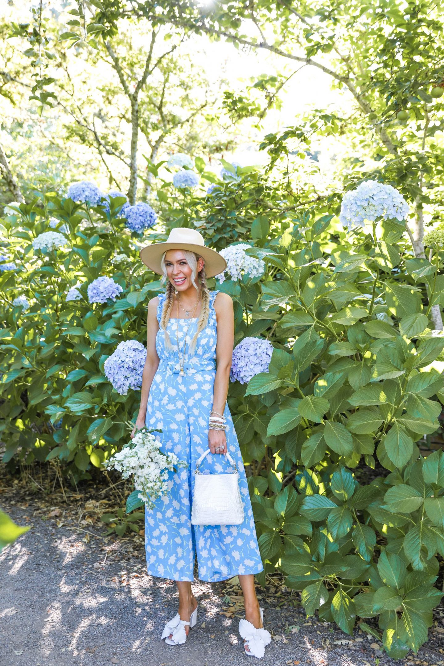 Favorite moments at Filoli Gardens. Faithful the brand jumpsuit shopbop in a hydrangea garden in Filoli, featured by San Francisco style blogger Lombard and Fifth.