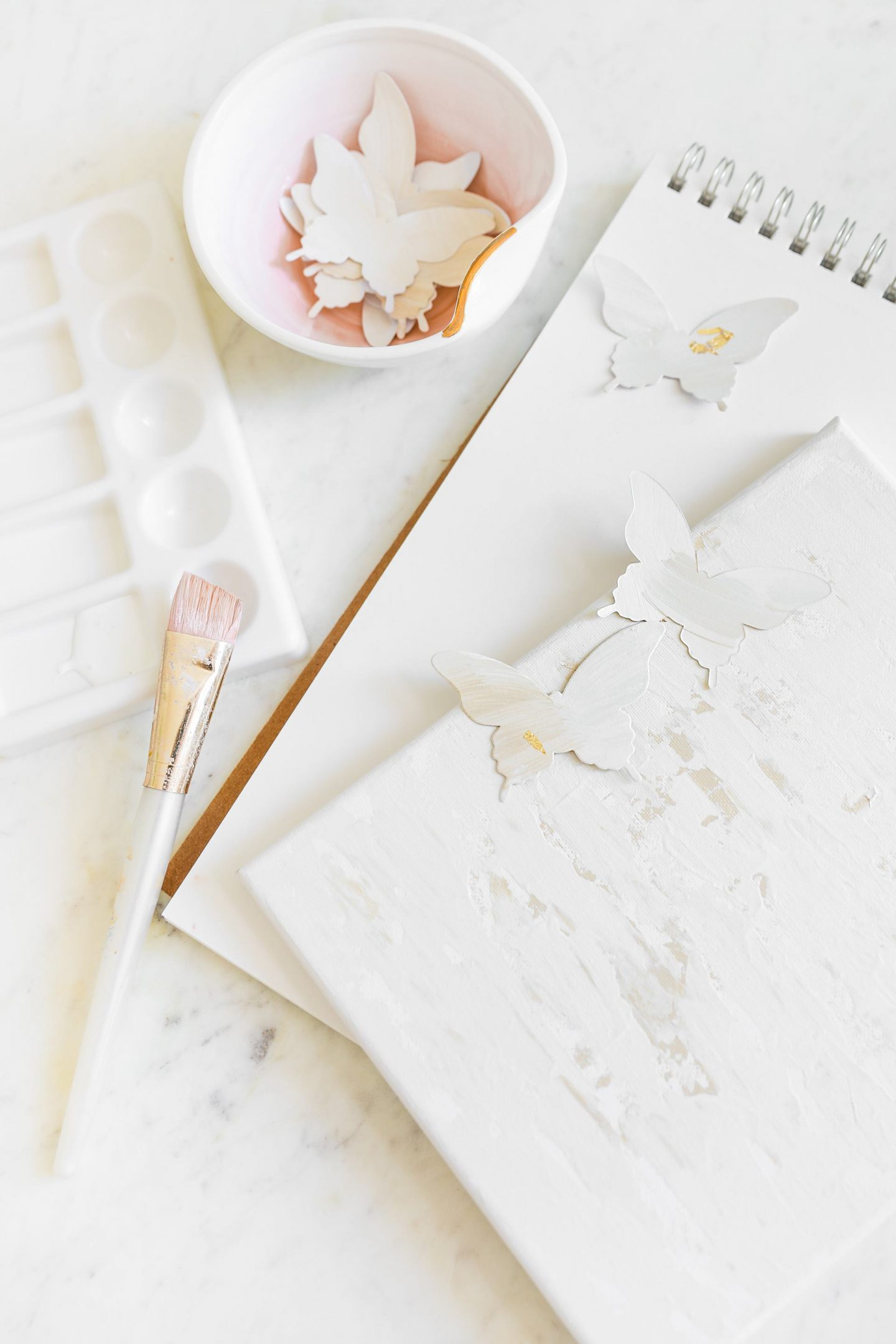 How to update your wall décor with a simple DIY paper butterfly painting, featured by San Francisco style blogger Lombard and Fifth.