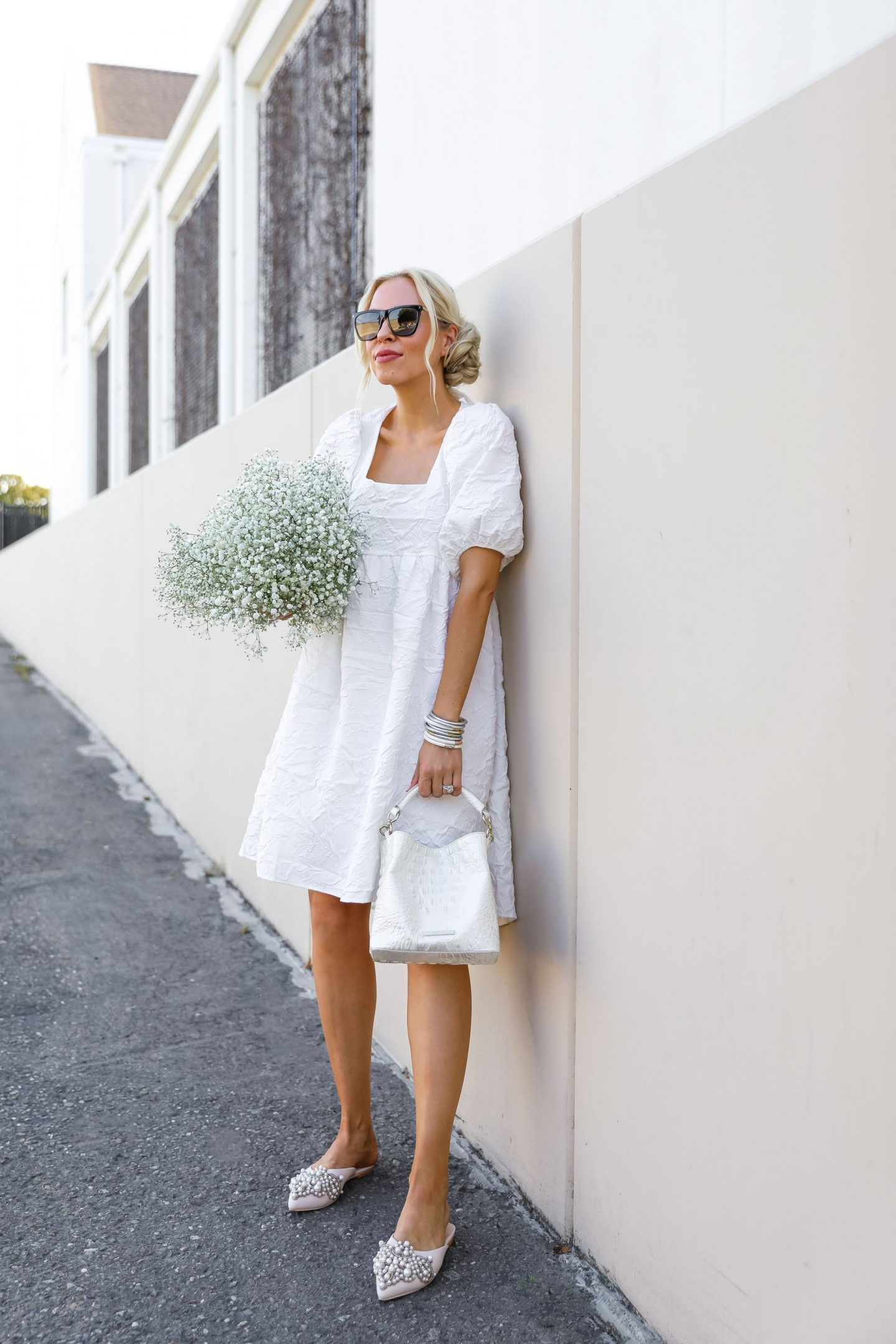 White Vita Grace midi dress with budha girl bracelets, feminine style by fashion blogger Lombard & Fifth.