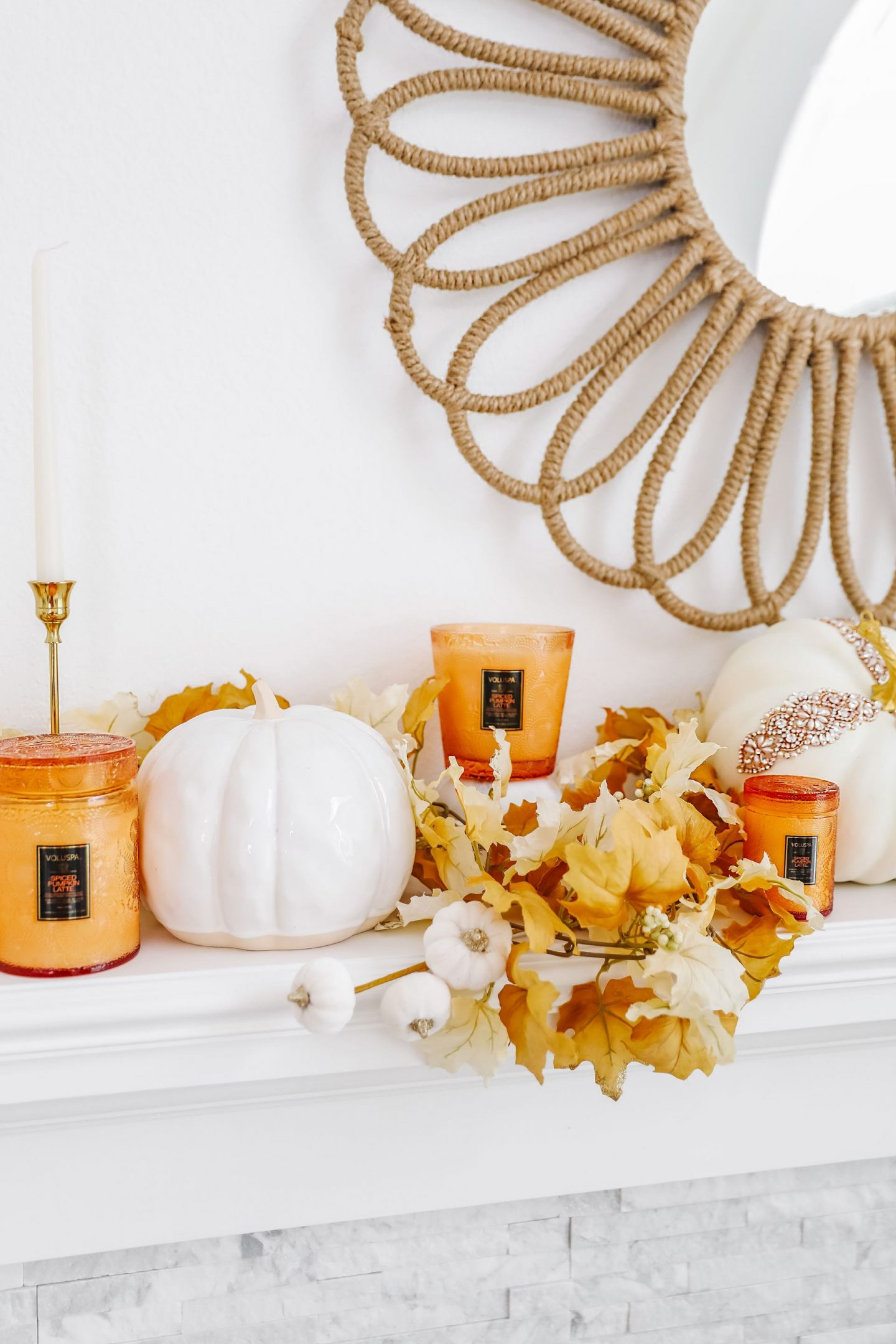 Easy glam neutral fall décor mantle update ideas. Glass pumpkins, voluspa pumpkin spice candles.