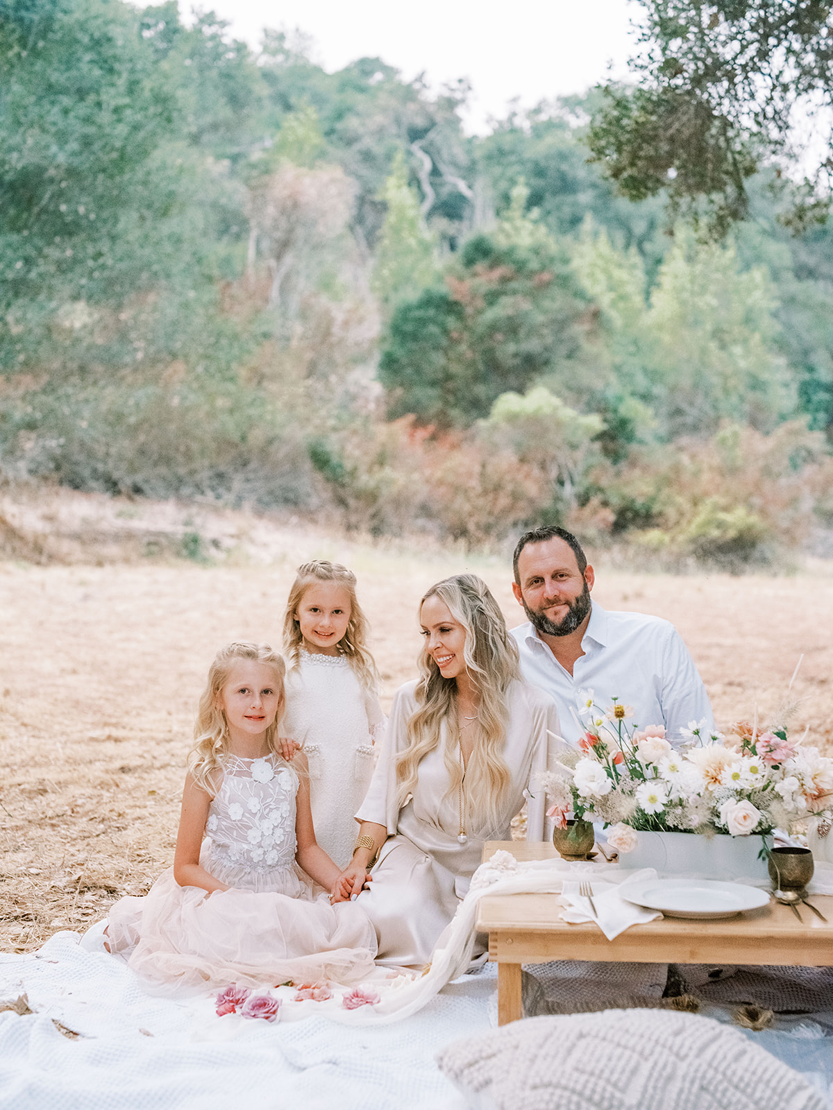 Whimsical boho picnic photoshoot ideas, with family in an outdoor location, featured by San Francisco fashion blogger Lombard & Fifth.