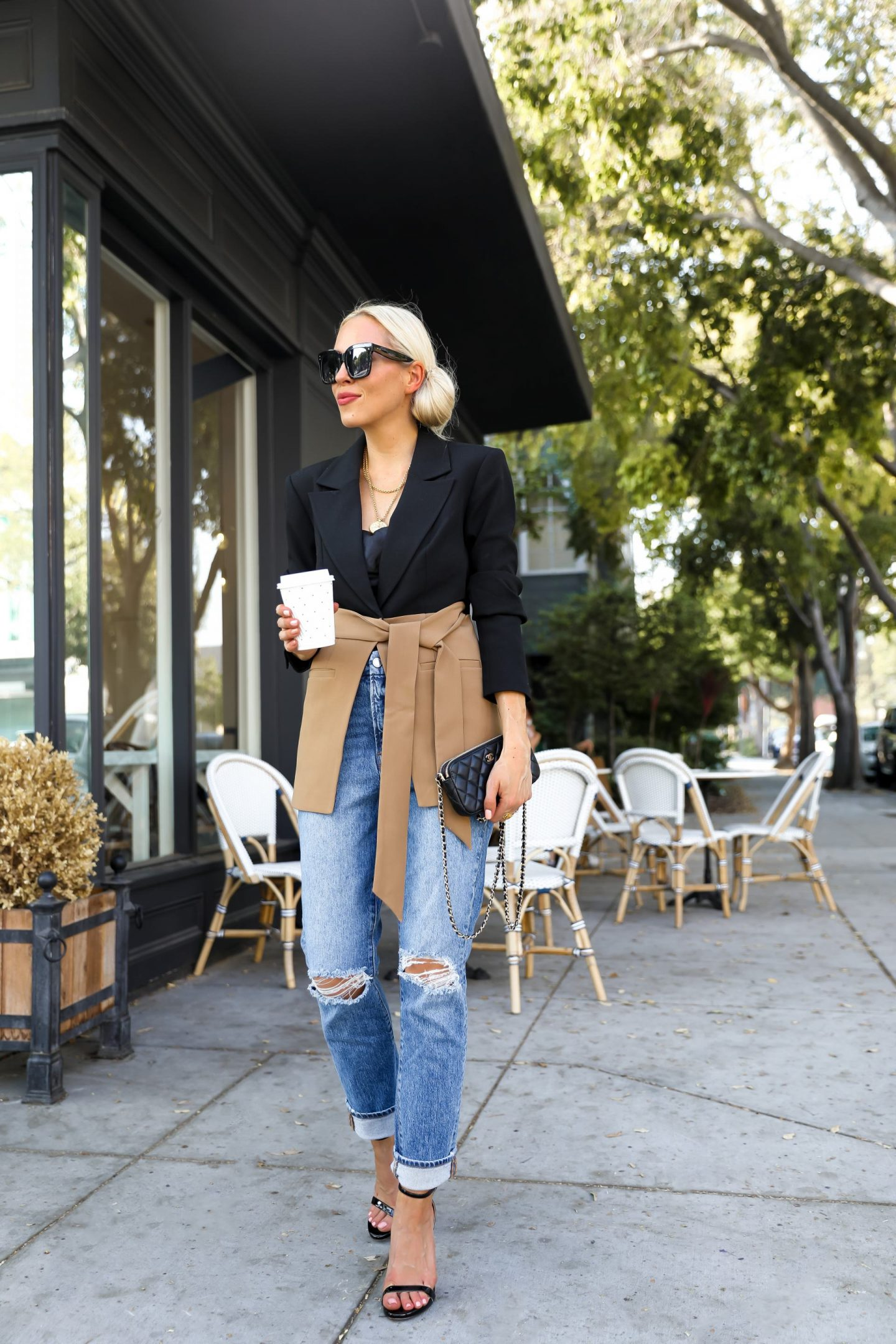Good American side slit two-tone blazer, with denim casual chic style, by San Francisco fashion blogger Lombard & Fifth. French coffee shop.