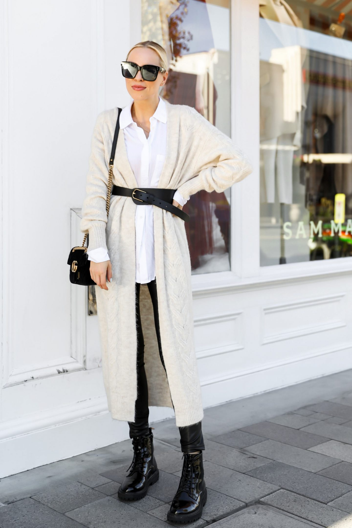 Best winter style from Nordstrom made brands featured by San Francisco fashion blogger Lombard & Fifth. Beige sweater with vegan leather leggings and statement belt.