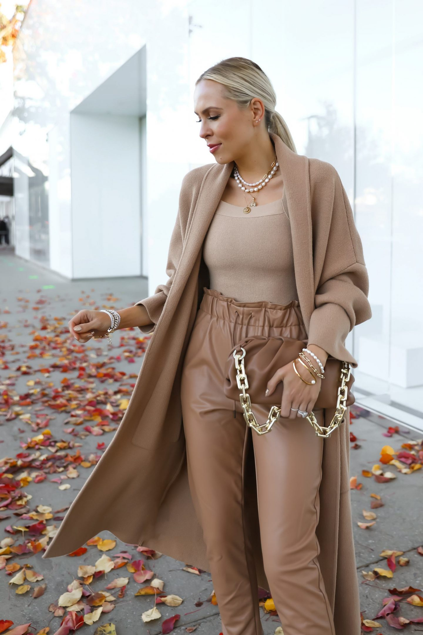 Victoria Emerson 50% off sale, featuring new gold pearl collection, wearing neutral coatigan layers from Mango and vegan leather joggers. Neutral style. Lombard & Fifth.