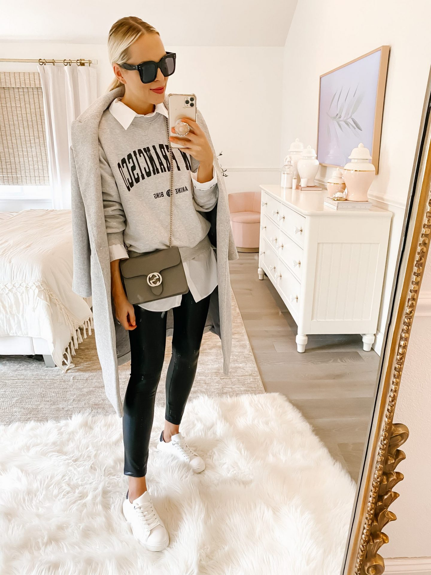 How to style casual chic layers and leggings for winter, by fashion blogger Lombard & Fifth. Express Sherpa white coat, commando leather leggings, Anine Bing sweatshirt, camel coat.