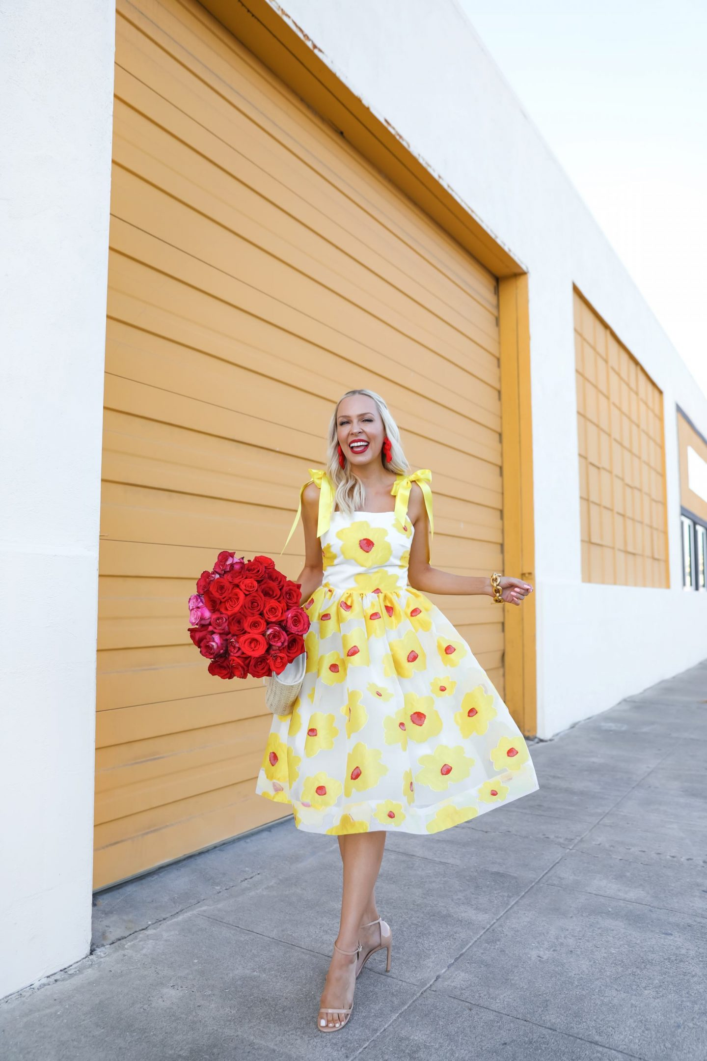 Independent designer spotlight, MAE Karalena yellow bow dress red roses, featured by Lombard & Fifth Veronica Levy. Small business feature, feminine fashion made in NYC.