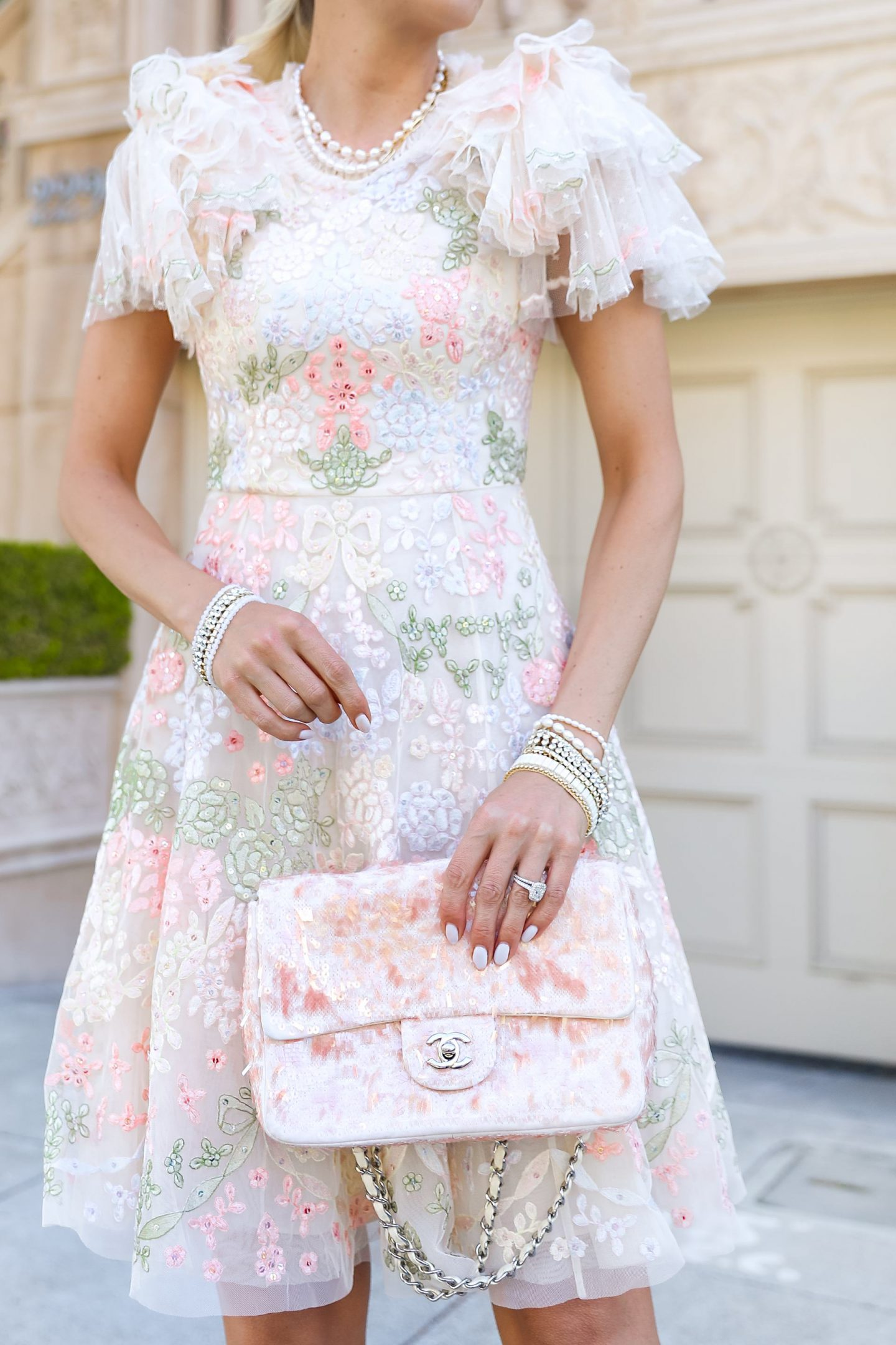 Victoria Emerson bracelet sale, styling Needle & Thread Elin Blossom embroidered tulle mini dress in cream with pearl necklace and neutral bracelets in Pacific Heights, San Francisco. By Lombard & Fifth, Veronica Levy.