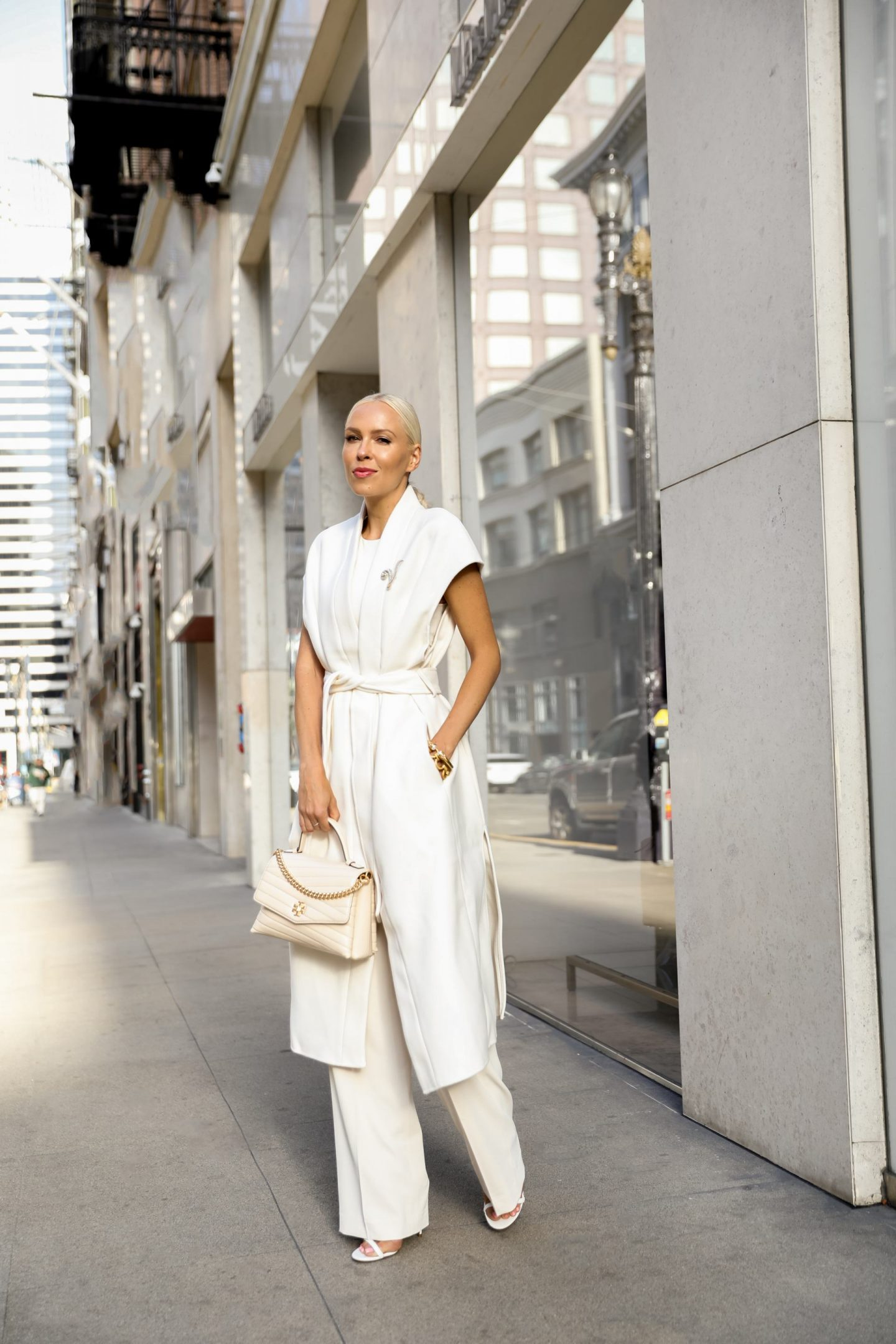 Neutral fall favorites from H&M, style inspiration. Sleeveless ivory long coat, monochromatic look, by Lombard & Fifth Veronica Levy.