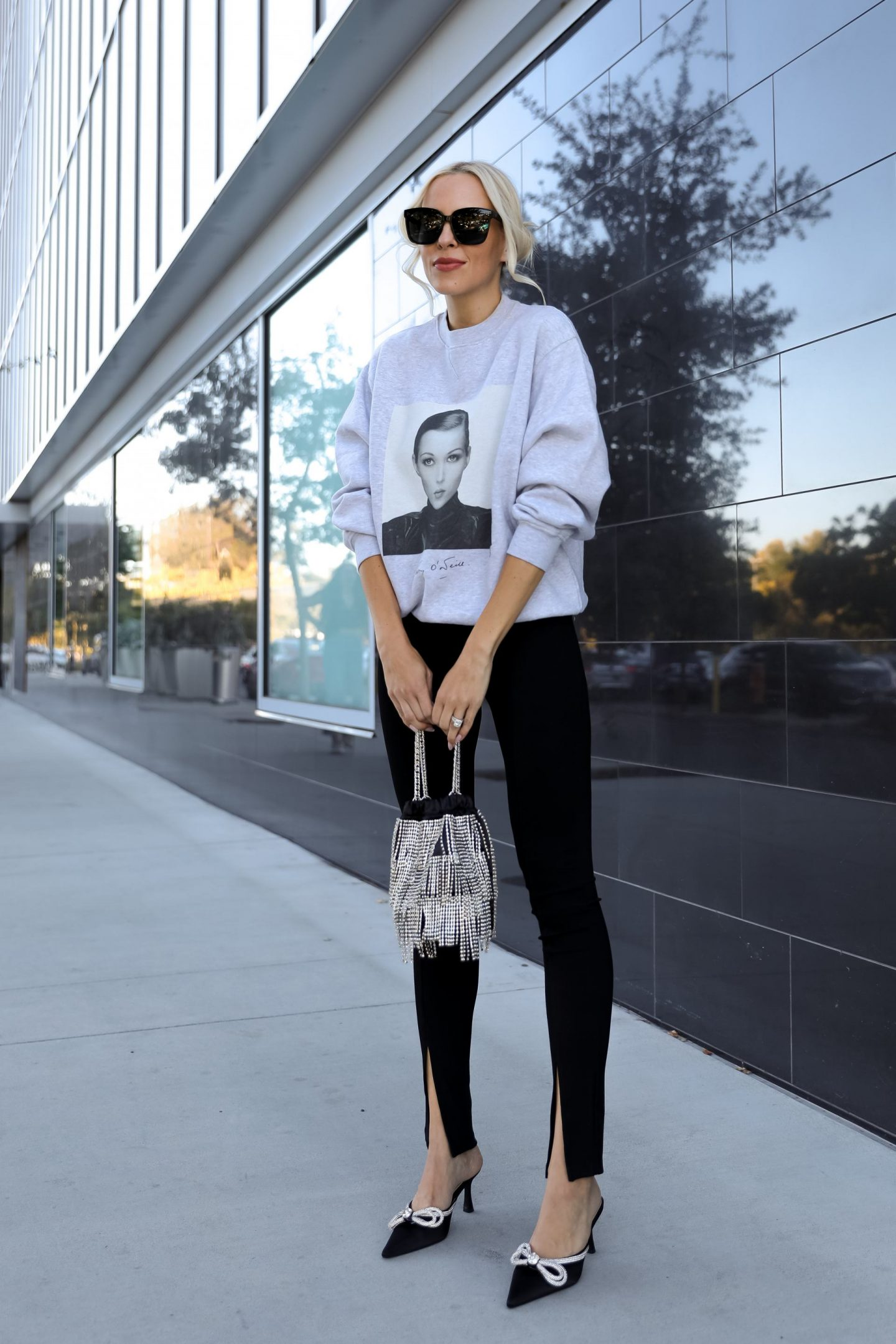 Casual glam style, Anine Bing Ramona Sweatshirt AB X TO Kate sweatshirt with H&M slit detail black leggings and satin embellished double bow rhinestone mules from Outdazl. Fall style, by Veronica Levy of Lombard & Fifth.